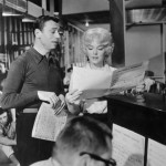 Marilyn Monroe and Yves Montand rehearsing at the piano