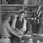 James (right) in his father's store after the war