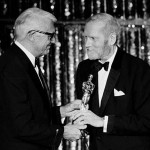 Laurence Olivier accepts honorary Oscar from Cary Grant