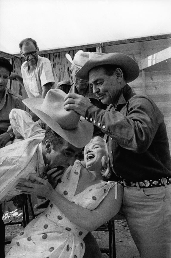 Joking around with Clark Gabe and Montgomery Clift on the set of The Misfits Arthur Miller in the back