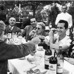 Ava Gardner next to boyfriend Luis Miguel and across from Ernest Hemingway
