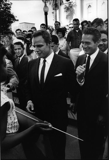 Paul at a civil rights rally with Marlon Brando