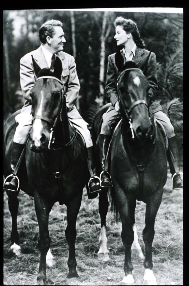 Spencer Tracy and Katharine Hepburn riding horses