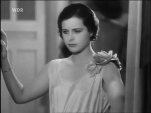 Hedy in a cameo as a teenager