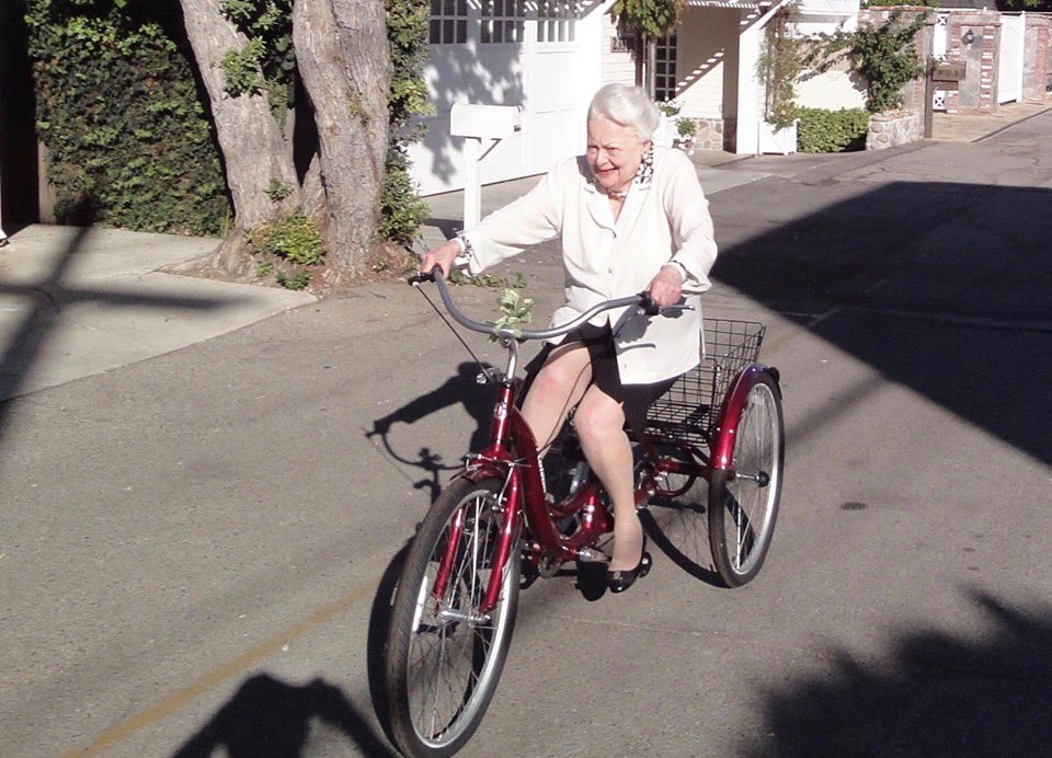Olivia de Havilland on bike